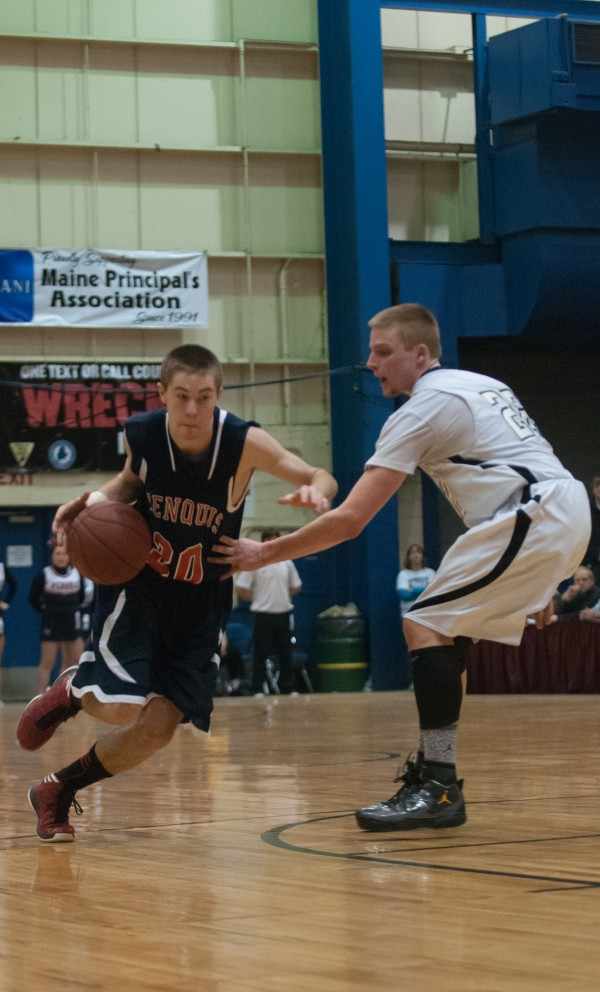 Penquis Valley's  Jason Durant (left) drives against Houlton's Daniel Swallow (right) during the Eastern Maine Class C title  game at the Bangor Auditorium on Saturday, February 23, 2013.