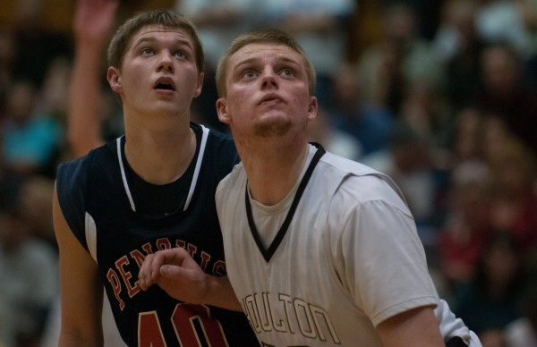 Penquis Valley's  Cody Herbest (left) and Houlton's Daniel Swallow (right) watch a free throw attempt during the Eastern Maine Class C title  game at the Bangor Auditorium on Saturday, February 23, 2013.