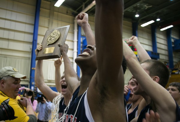 The Penquis Valley boys basketball team celebrates after winning the Eastern Maine Class C title  at the Bangor Auditorium on Saturday, February 23, 2013.