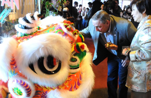 Gov. Paul LePage brushes the eye of the lion to awaken it during a ceremony marking the Chinese New Year Sunday. According to Chinese tradition, the awakened lion chases away the evil spirits. The celebration was hosted at the Oriental Jade restaurant in Bangor. On the right is Lilian Lo, the co-owner of Oriental Jade.