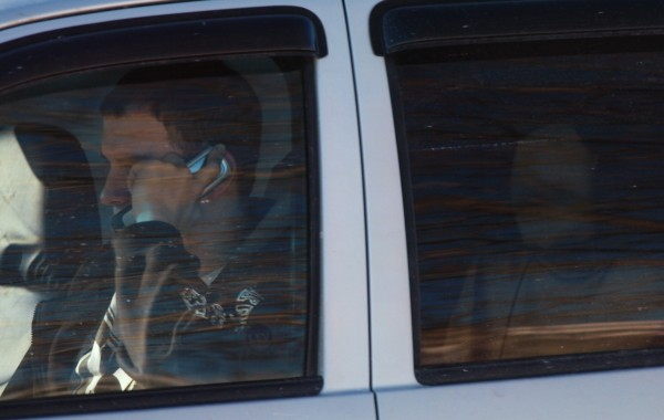 A driver talks on a cellphone while traveling south on Broadway in Bangor.