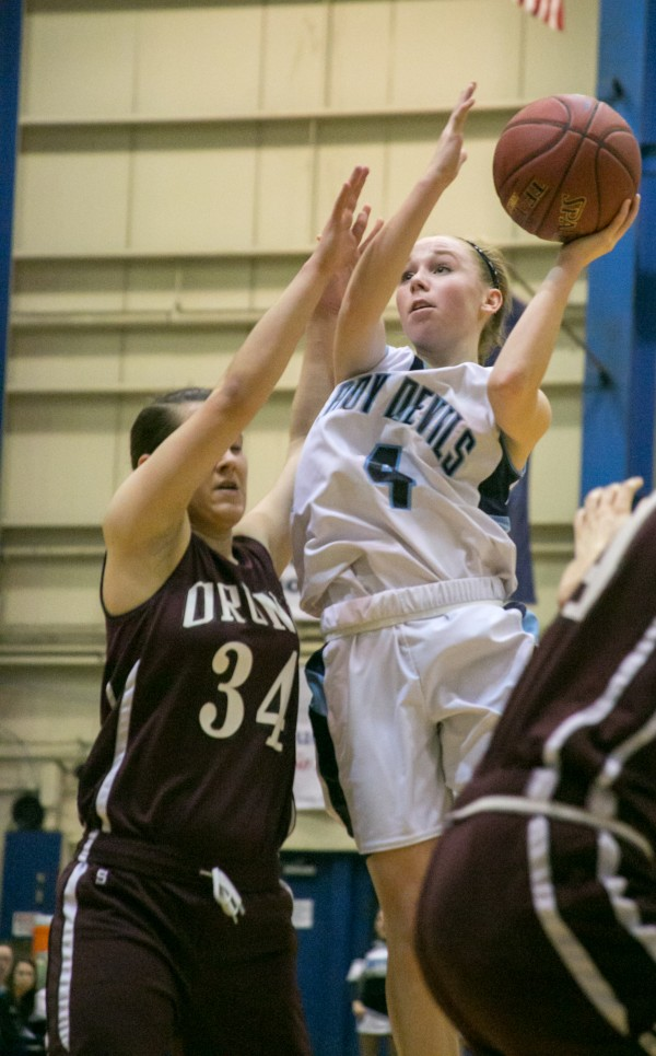 Calais' Madison McVicar (right) drives the lane and shoots over Orono's Elea Kass during the Eastern Maine Class C title game at the Bangor Auditorium on Saturday, February 23, 2013.