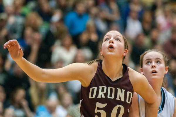 Orono's Jillian Woodward (left) tries to box out Calais' Paige Gillespie during the Eastern Maine Class C title game at the Bangor Auditorium on Saturday, February 23, 2013.