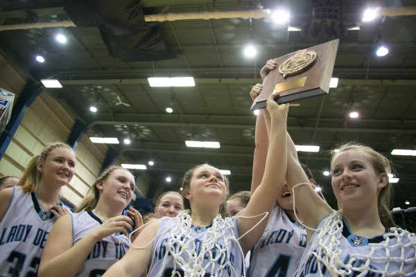 The Calais girls basketball team celebrates after winning the Eastern Maine Class C title at the Bangor Auditorium on Saturday, February 23, 2013.