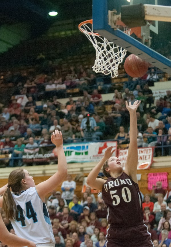 Orono's Jillian Woodward (right) shoots a layup against Calais'Paige Gillespie during the Eastern Maine Class C title game at the Bangor Auditorium on Saturday, February 23, 2013.