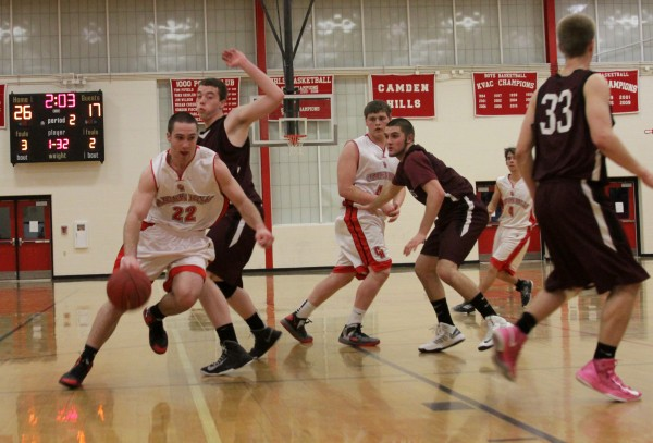 Camden Hills' Connor Hart drives from the wing against Nokomis on a crowded court during an Eastern Maine Class B prelim Wednesday night.