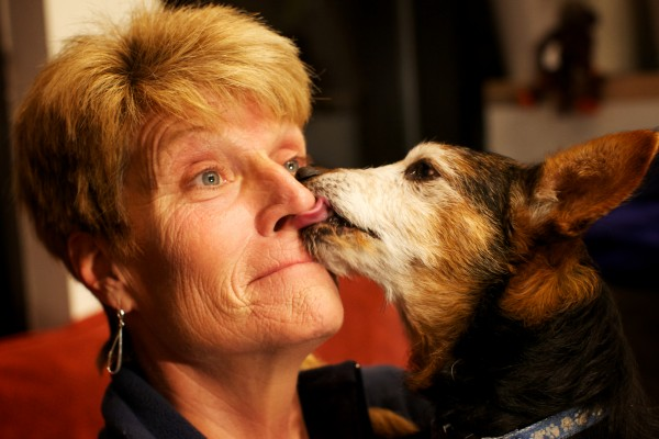 Linda Walton of Saco gets a winning 45-second smooch from her 12-year-old dog Beau Tuesday night Feb. 12, 2013 at the 9th Annual Valentine's Day Canine Kissing Contest and Cocktail Party at the Planet Dog Company Store in Portland.