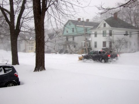A plow truck heads for another job on Maple Street in Bangor.