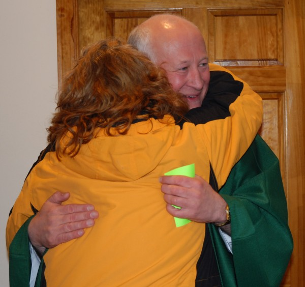 Father James Nadeau accepts a hug from a parishioner after mass Thursday night in Soldier Pond. Nadeau was cleared last November of allegations of embezzlement following a 10 month voluntary leave of absence. Thursday's mass was his first one since returning to his parish.