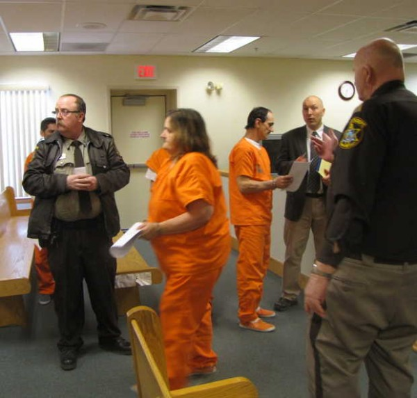 Five arrested on drug charges involving a woman's death in in November 2012 appear in 12th District Court in Farmington on Friday. Suspect Terry Oliver, 53, of Wilton, center foreground, prepares to leave the court as suspect Roy Gordon, 42, of Wilton talks with lawyer David Joyce, background right. Also in court were suspects Erick Barnes, 27, of Industry, Seth Gordon, 23, of Wilton and Scott Kidder, 32, of Wilton.