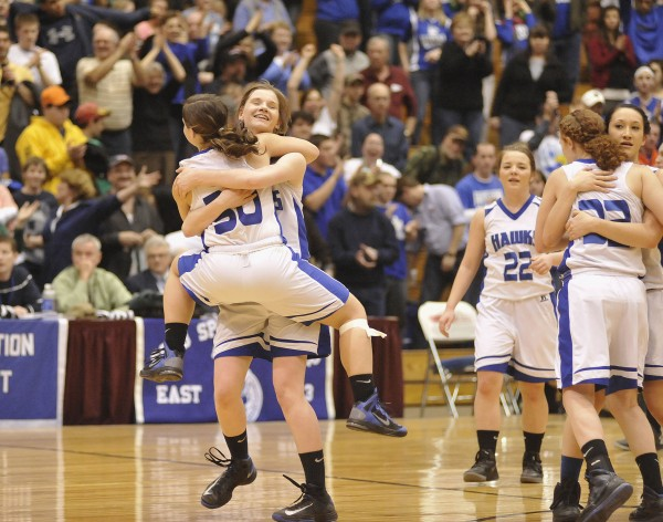 Hodgdon's Mariah Wiley (30) and Jennah Steamer (44) celebrate  their team's victory over the Van Buren in their Eastern Maine Class D playoff game at the Bangor Auditorium, Saturday, Feb. 16, 2013.