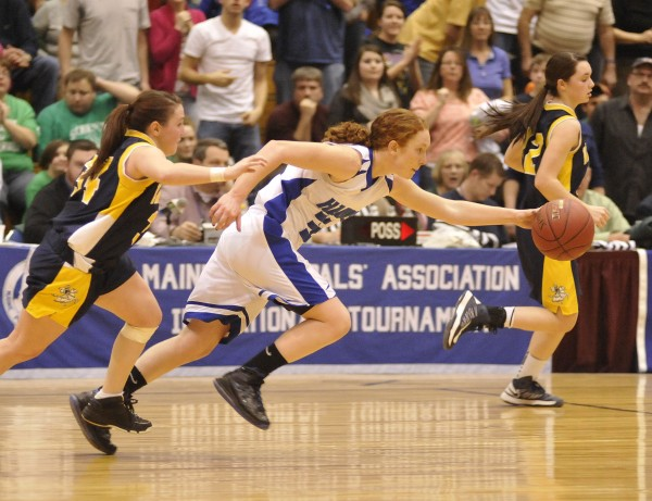 Hodgdon's Lacey McQuarrie races for a loose ball as she drives into the offensive end chased by Van Buren's Kayla Durette (34) in the second half of their Eastern Maine Class D playoff game at the Bangor Auditorium, Saturday, Feb. 16, 2013.