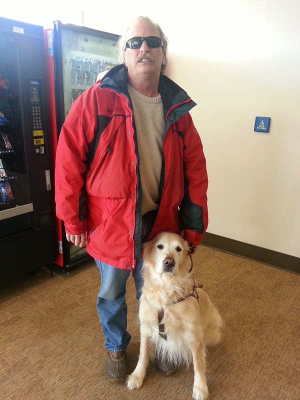 Bruce Archer and his seeing-eye golden retriever, Flash, pose Monday morning, Feb. 25, 2013, after learning that the Maine Human Rights Commission found that Archer has reasonable grounds to believe he was discriminated against by the Great Wall Buffet in Augusta.