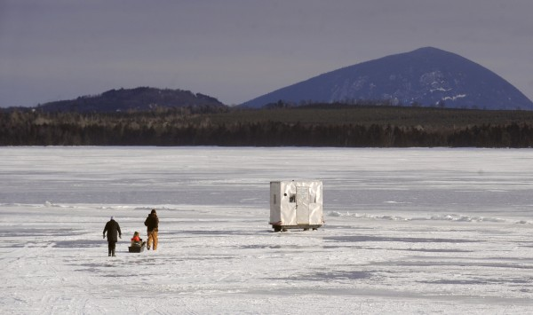 Janie Pitcher (left) and her husband Peter of Etna walk to their ice shak on Moosehead Lake in late January. They said that the lake froze later then usual, delaying the start of the season.