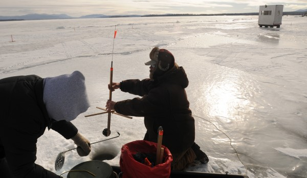 Janie Pitcher (left) and her husband Peter of Etna set a tip-up while ice fishing in Rockwood on Moosehead Lake in late January. &quotWe probably will not catch anything here, but it's just fun to be out fishing,&quot Peter Pitcher said.