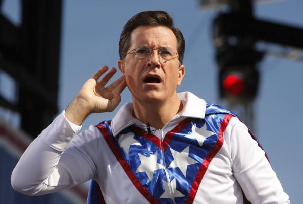 Comedian Stephen Colbert gestures during the &quotRally to Restore Sanity and/or Fear&quot in Washington in this file photo taken October 30, 2010.