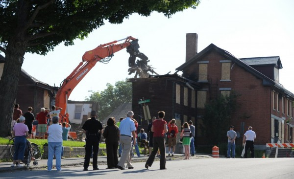 A crowd gathers at the intersection of Bennoch Road and Forest Ave. in Orono on Tuesday, August 4, 2009, to watch the demolition of the historic Katahdin Building located at 6 Bennoch Road. Fire damage from a June 9, 2009 fire damaged the building beyond repair.