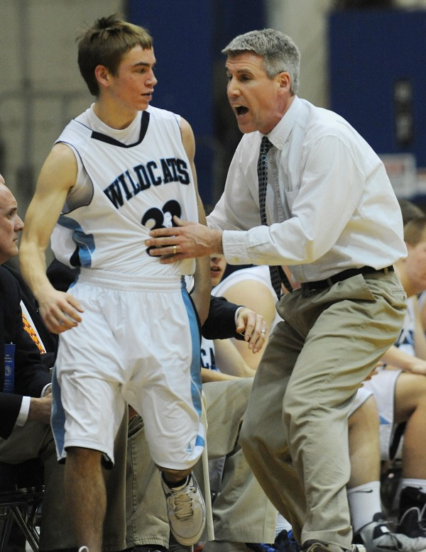 Presque Isle's head coach Terry Cummings shouts instructions to Jacob Williams as he sends him into the game gainst MDI on Wednesday at the Bangor Auditorium during class B tourney action.