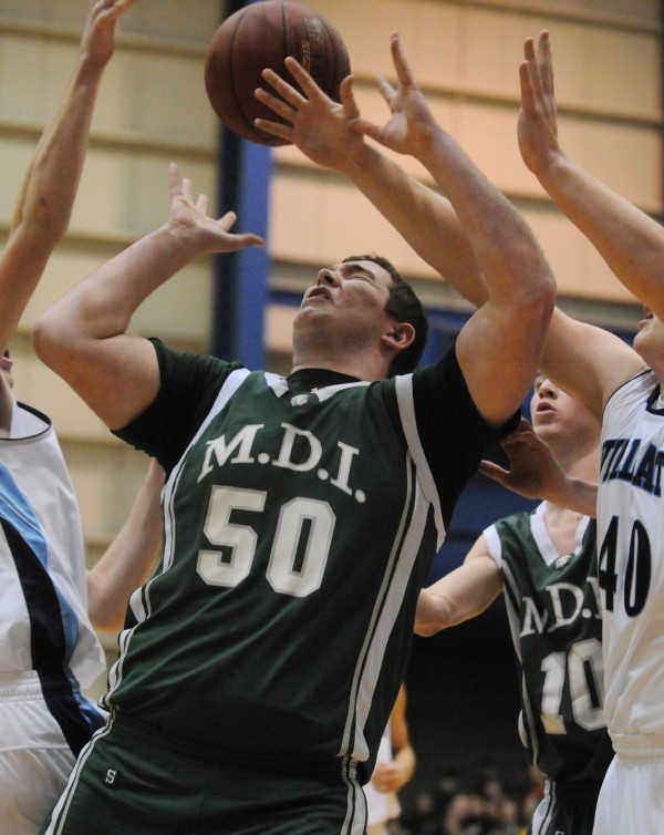 MDI's Adam Gray gets the ball knocked out of his hands while rebounding against Presque Isle on Wednesday at the Bangor Auditorium during Class B tourney action.