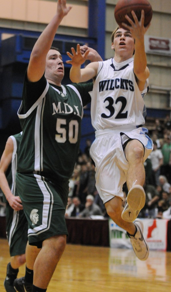Presque Isle's Jacob Williams drives ot the hoop against MDI's Adam Gray on Wednesday at the Bangor Auditorium during Class B tourney action.