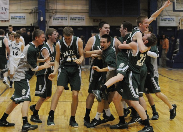 MDI's boys basketball team celebrates its victory over Presque Isle 51-40 on Wednesday at the Bangor Auditorium during Class B tourney action.