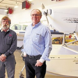 Maine Aero Services General Manager Ray Lane (left) and President Gene Richardson stand near a Cessna 172 Skyhawk (right) and a twin-engine Beechcraft Baron undergoing maintenance in the MAs hangar at Bangor International Airport. Maine Aero Services and the United Technologies Center are developing an FAA-certified aviation maintenance technician school that will be the only one of its kind in Maine.