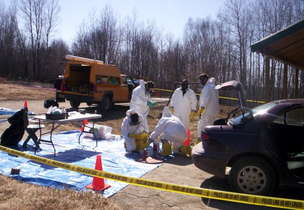 Agents of the Maine Drug Enforcement Agency collect evidence at a suspected methamphetamine lab on Fontaine Drive in Caribou in April 2006.