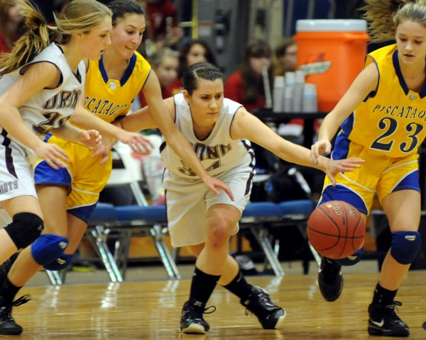 Orono's Hannah Clement, Piscataquis' Alex Speed, Orono's Elea Kass, and Piscataquis' Mikayla Dow (left to right) go after a loose ball second half action of the girls Class C quarterfinal game Tuesday morning at the Bangor Auditorium. Orono won the game 45-40 in overtime.