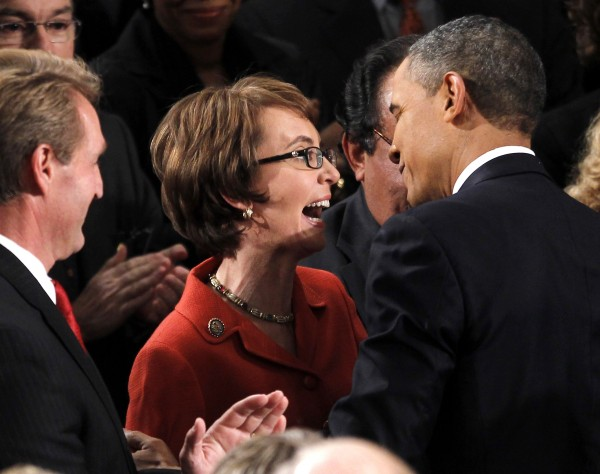 President Barack Obama greets retiring Rep. Gabrielle Giffords, D-Ariz., on Capitol Hill in Washington, Tuesday, Jan. 24, 2012, prior to delivering his State of the Union address.