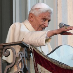 Pope Benedict XVI waves as he appears for the last time at the balcony of his summer residence in Castelgandolfo, south of Rome, February 28, 2013.