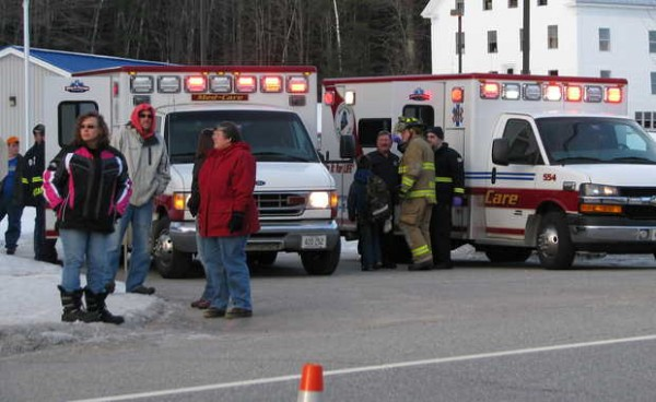 Parents of schoolchildren on two school buses involved in a multivehicle accident Friday afternoon on Route 2 in Hanover wait for firefighters to escort their children to waiting ambulances in the Hanover Post Office parking lot for evaluation before parents could then take their children home.