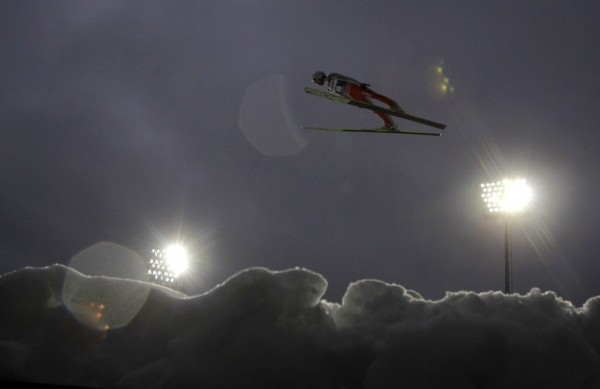 Simon Ammann of Switzerland soars through the air during his practice jump at the World Cup Ski Flying competition in Harrachov on Feb. 1, 2013.