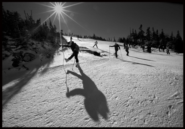 Racers stretch at the top of the Narrow Gauge trail before competing in the Eastern Cup Super G, Tuesday, Feb. 5, 2012, at Sugarloaf.