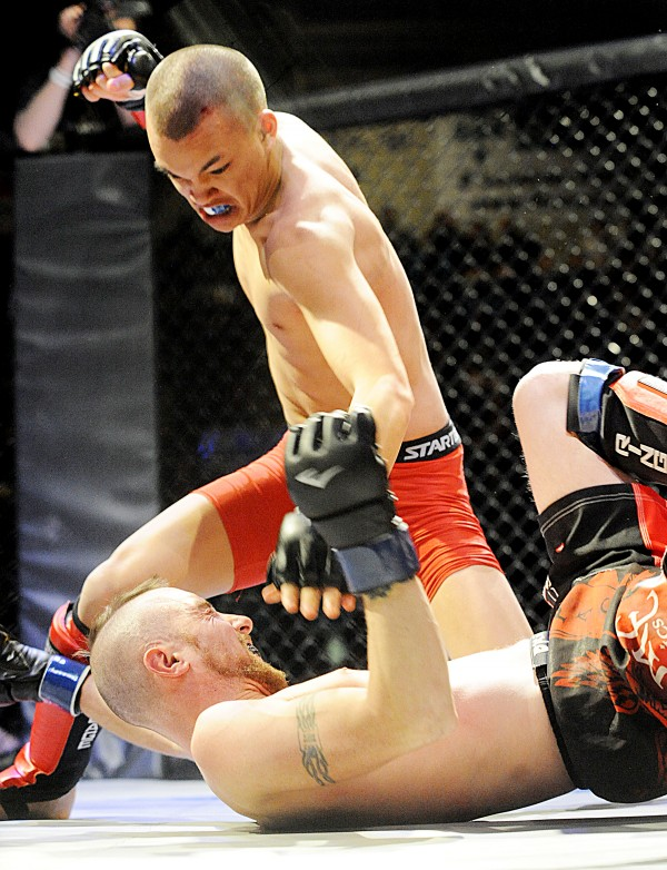 Conner Murphy, top, from Auburn, winds up to land a punch on John Parker, from Jonesport, during their 125 pound amateur match Saturday during Fight Night VI at the Androscoggin Bank Colisee. Murphy took the win after Parker tapped out to strikes at 1 minute, 52 seconds in the first round.