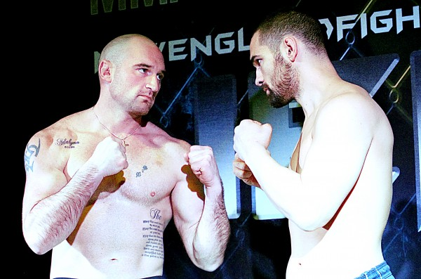 Jesse Peterson, left, faces off for a promo photo against Greg Rebello after their weigh-in at the Ramada in Lewiston Friday in preparation for tonight's Fight Night VI at the Androscoggin Bank Colisee.  Peterson and Rebello will be fighting for the Maine State Light-Heavyweight Championship.