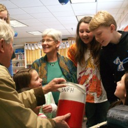 Anna Wood-Cox's Drinkwater School fifth graders take delivery of 200 salmon eggs from Tom King of BBWC.  Debbie Mitchell photo.