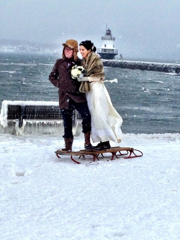 Gregory Beal and Karen Willis pose for photos in front of Spring Point Light after getting married during the record snowstorm that hit Portland on Saturday.