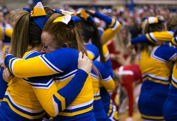 Members of the Hermon cheerleading team celebrate after winning the Class B state championship on Monday, February 11, 2013.
