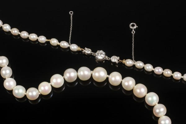 Single strand of graduated natural pearls with Tiffany & Co. 18K gold clasp and 3 European cut diamonds that sold for $143,750 at Thomaston Place Auction Galleries