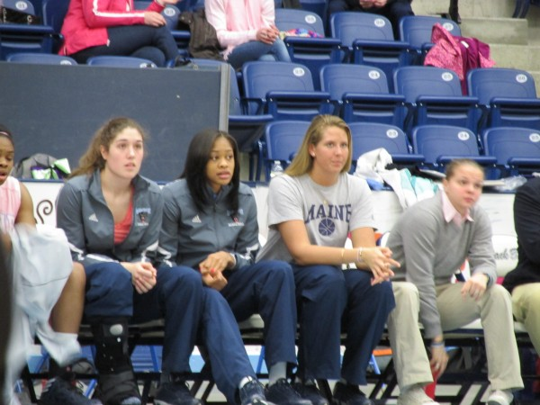 Danielle Walczak (left), Corinne Wellington and Ali Nalivaika of the University of Maine watch Saturday's game against Albany at Alfond Arena. Walczak and Wellington recently suffered injuries that will require surgery and sideline them for the rest of the season. Nalivaika was hurt during preseason and has not played.