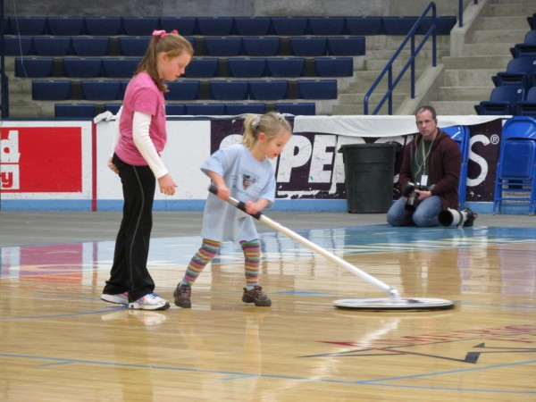 Two youngster mop up the court at Alfond Arena during halftime of Saturday's game in Orono between the University of Maine and the University at Albany. The Great Danes won 86-54.