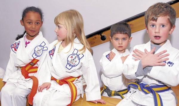 Youngsters enrolled in the Hampden ATA School watch a blackbelt demonstration during a belt-awarding ceremony held Thursday, Jan. 31, 2013 at the Reeds Brook Middle School in Hampden. The Hampden ATA School teaches taekwando.