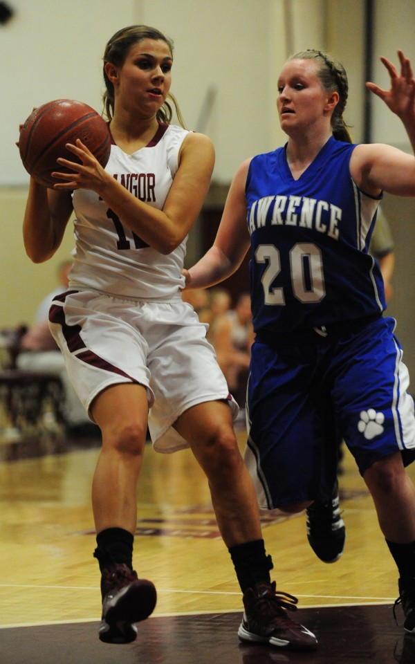 Bangor's Jordan Seekins looks to pass the ball with pressure from Lawrence's Jordyn Towers on Tuesday at Bangor.