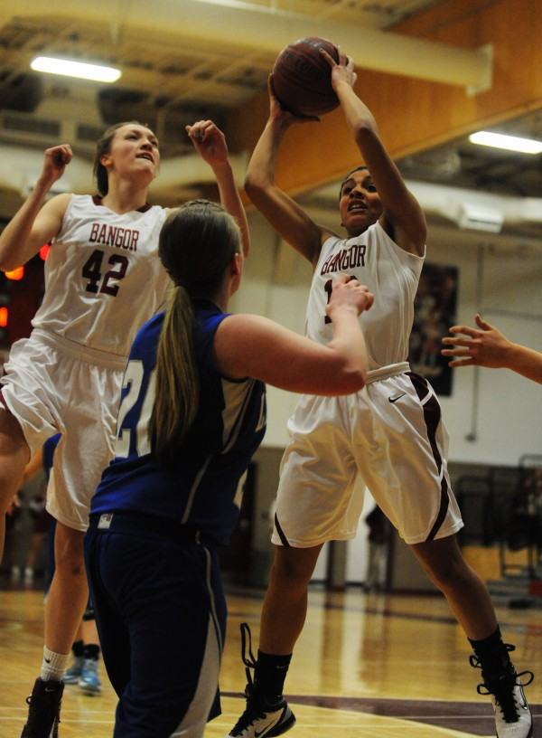 Bangor's Deanae Johnson pulls down a rebound against Lawrence  on Tuesday at Bangor. Also in on the play are Bangor's Mary Butler and Lawrence's Dominique Lewis.