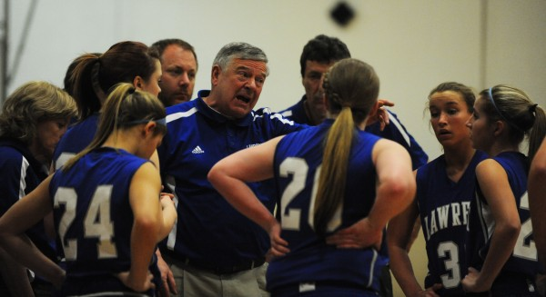 Lawrence head coach John Danato talks with his players during first quarter action at Bangor on Tuesday.
