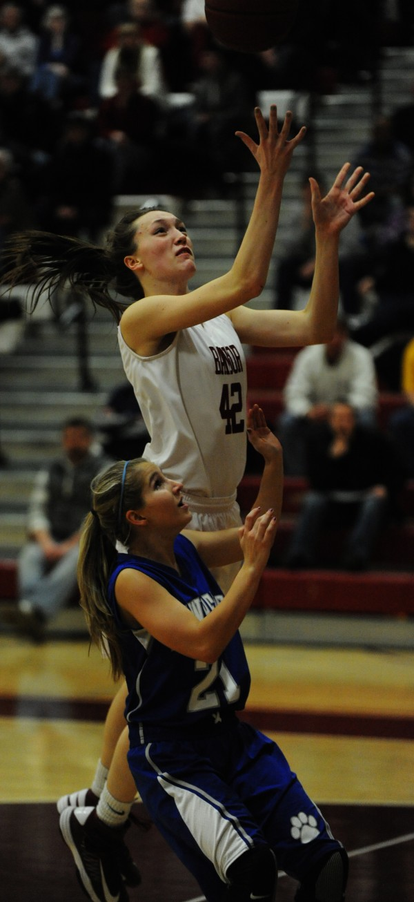 Bangor's Mary Butler shoots the ball with pressure from Lawrence's Dominique Lewis on Tuesday at Bangor.