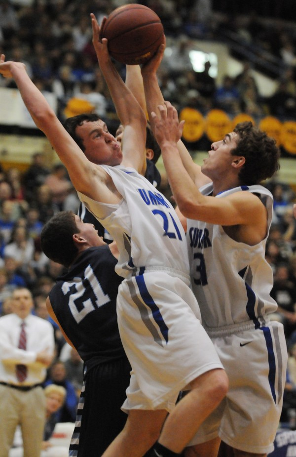 Sumner teammates Allen Doughty, left, and Samuel Smith colliodes as they pull down a rebound together during first half action Tuesday at the Bangor Auditorium during class D tourney action.