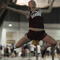 Bangor's Grace McLean sets a new PVC track record in the long jump on Monday at the UMaine on Monday.