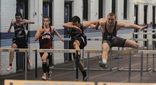 Foxcroft Academy's Don Boyer, right, clears hurdles in the 55 meter hurdles to go on to win the event during the PVC Eastern Maine Indoor Track Championship  Monday at the UMaine on Monday.
