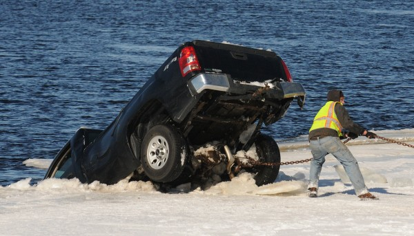 A pick-up truck is removed from the Penobscot River in Passadamkeag after it was found in the water. The driver was reported missing but police were unable to locate him or the vehicle due to the blizzard conditions. The vehicle was located Sunday morning and the driver was found dead. The truck was removed from the river around noon after the body of the driver was taken out by divers.